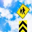 School warning traffic road sign on beautiful sky — Stock Photo