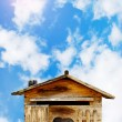 Old wood house postbox on beautiful sky - Stock Photo