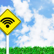 Wi-fie wireless internet sign on beautiful sky - Stock Photo