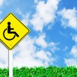 Handicapped disabled sign on beautiful sky — Stock Photo