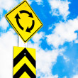 Traffic circle road sign on beautiful sky — Stok fotoğraf