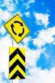 Traffic circle road sign on beautiful sky — Stock Photo