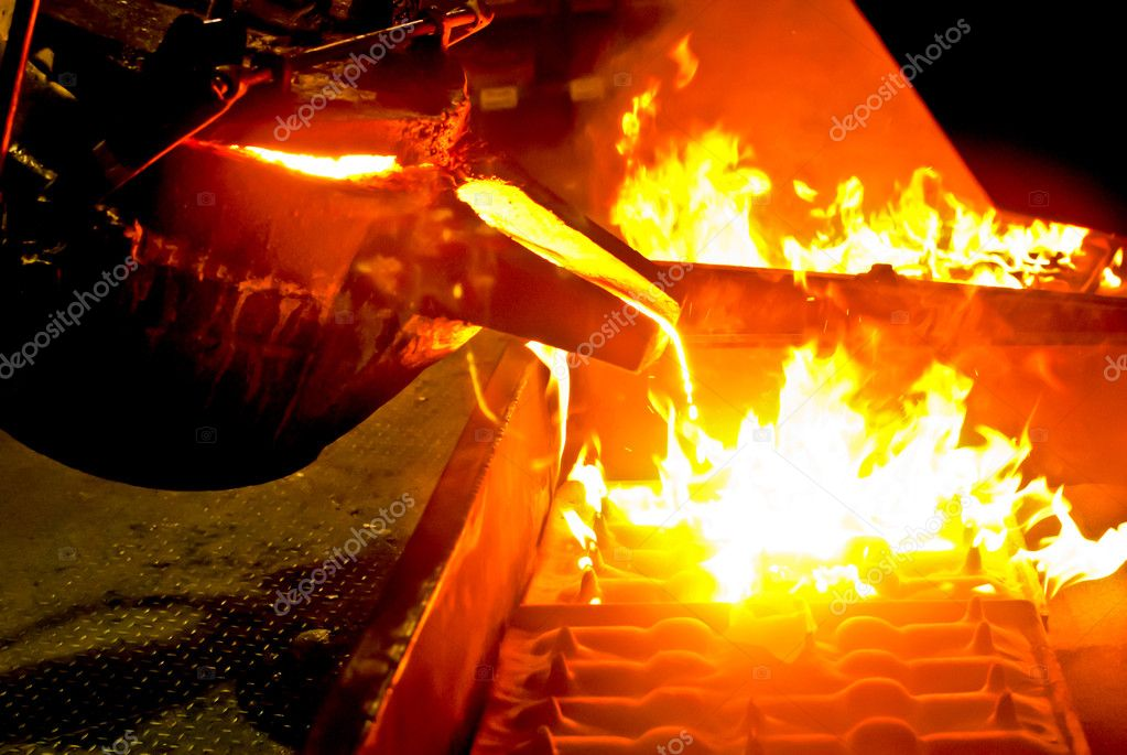 Metal casting process with high temperature fire in metal part factory  Stock Photo #4798447