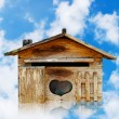 Royalty-Free Stock Photo: Old wood house postbox on beautiful sky