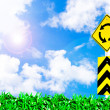 Traffic circle road sign on beautiful sky — Stock Photo #4802762