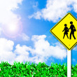 School warning traffic road sign on beautiful sky — Stock Photo #4802775