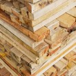 Stack of lumber in logs storage closeup — Stock Photo