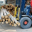 Stock Photo: Truck loading pile of wood in logs storage