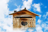 Old wood house postbox on beautiful sky — Stock Photo