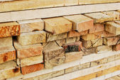 Stack of lumber in logs storage closeup — Stock Photo