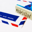 Urgent stamp on air mail - Stock Photo