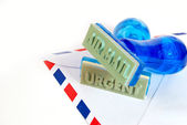 Urgent stamp on air mail — Stock Photo