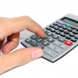 Hand using advance calculator isolated — Stock Photo #4937569