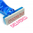 Delivered blue rubber stamp — Stock Photo