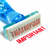 Important blue rubber stamp - Stock Photo