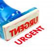 Urgent blue rubber stamp - Stock Photo