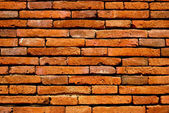 Old orange brick wall background — Stockfoto