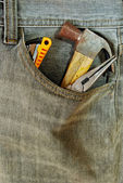 Repairman jean with tool in pocket — Stock Photo