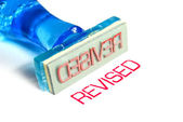 Revised blue rubber stamp — Stock Photo