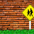 School warning sign on brick wall - Stock Photo
