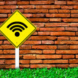 Wi-fi internet symbol on brick wall - Stock Photo