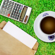 White cup of coffee and brown envelope - Stock Photo