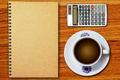 White cup of coffee and notebook — Stock Photo