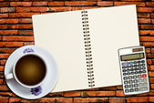 White cup of coffee and calculator — Stock Photo