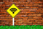 Wi-fi internet symbol on brick wall — Stock Photo