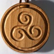 Medallion of wood carving of Celtic origin with triskell — Stock Photo