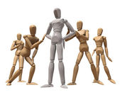 Several wooden mannequins — Stock Photo