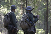 German soldiers in the woods — Stock Photo