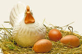 Egg with a hen in a nest — Stock Photo