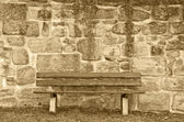 Wall with park bench — Stock Photo