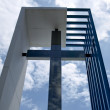 图库照片: Contemporary cross against the sky