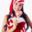 Santa girl holding a lollipop. Holidays Christmas And New Year. — Stock Photo #4438813