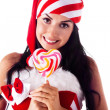 Stock Photo: Santa girl holding a lollipop. Holidays Christmas And New Year.