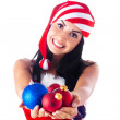 Santa girl holding a Christmas ball, Christmas toys.Holidays Christmas And — Stock Photo