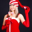 Santa girl holding a lollipop. Holidays Christmas And New Year. — Stock Photo