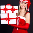 Stock Photo: Santa girl holding the box with gifts. Holidays Christmas and New year