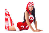 Santa girl is raising your feet up. Holidays Christmas And New Year. — Stock Photo