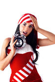 Santa girl holding a clock, alarm clock and wondering. Holidays Christma — Stock Photo