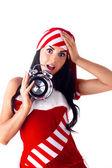 Santa girl holding a clock, alarm clock and wondering. Holidays Christmas A — Stock Photo