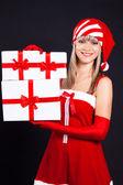 Santa flicka håller lådan med presenter. semester jul och nyår — Stockfoto