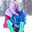 Happy mother and daughter in a winter park — Stock Photo