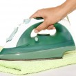 Hand with an iron and ironing a towel — Stock Photo #3958220