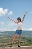 Girl is standing with hands up — Stock Photo