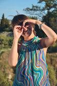 Girl hands binoculars on nature — Stock Photo