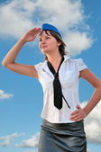 Attractive woman stewardess looks into the distance — Stock Photo