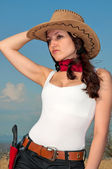 Girl in a cowboy hat in a field, portrait — Stock Photo